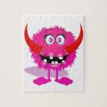 Monstruo mullido peludo rosado del dibujo animado rompecabezas