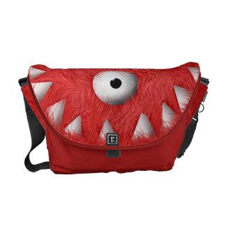 Monstruo peludo asustadizo rojo bolsa messenger