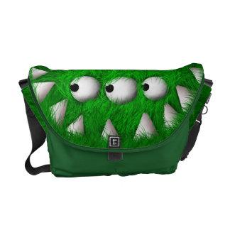 Monstruo peludo asustadizo verde bolsas de mensajeria