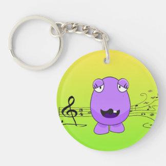 Monstruo púrpura chistoso que canta de llave llavero redondo acrílico a una cara