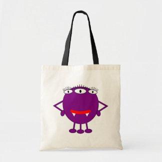 Monstruo púrpura lindo del dibujo animado bolsas de mano