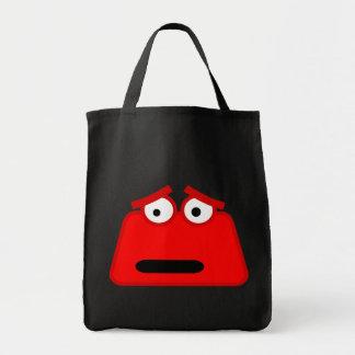 Monstruo rojo lindo del dibujo animado bolsas