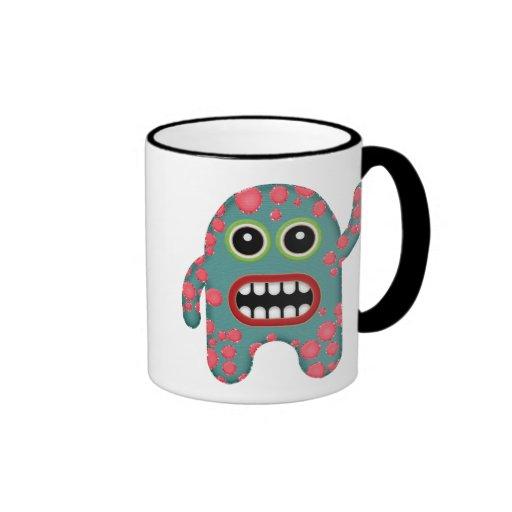 Monstruo sonriente dentudo azul y rosado lindo del taza