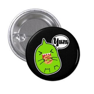 Monstruo verde con el botón de la galleta pins