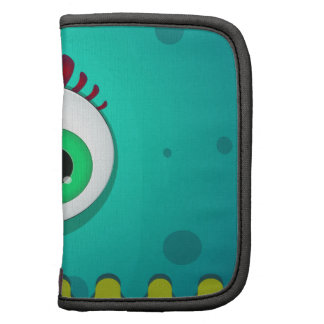 Monstruo verde de los cyclopes con un ojo enorme planificadores