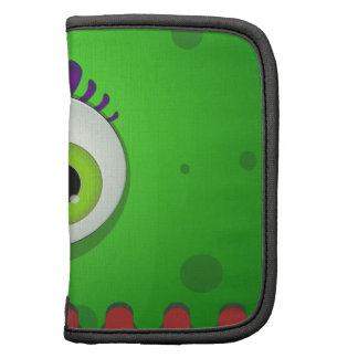 Monstruo verde de los cyclops con un ojo enorme organizadores