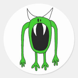 Monstruo verde pegatina redonda
