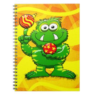Monstruo verde que celebra navidad libro de apuntes