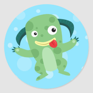 Monstruo verde tonto del dibujo animado pegatina redonda