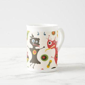 Monstruos felices taza de porcelana