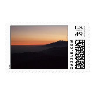 Montaña de la puesta del sol sellos