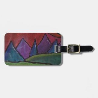 Montañas del color etiqueta para equipaje