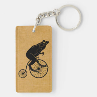Montar a caballo de la rana en una bici del comino llavero rectangular acrílico a doble cara