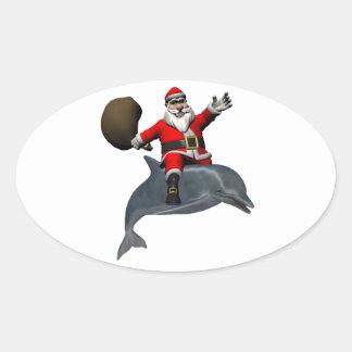 Montar a caballo de Papá Noel en delfín Pegatina Ovalada