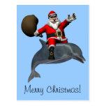 Montar a caballo de Papá Noel en delfín Tarjetas Postales