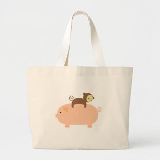 Montar a caballo del mono del bebé en un cerdo bolsas