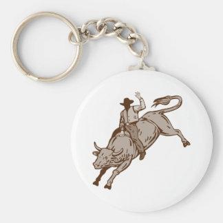 Montar a caballo del toro del vaquero del rodeo llaveros