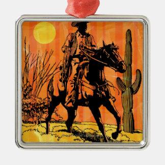 Montar a caballo del vaquero a caballo en desierto ornamento de navidad