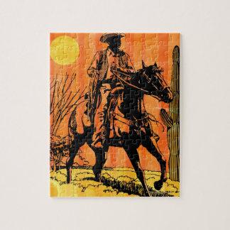 Montar a caballo del vaquero a caballo en desierto puzzle con fotos