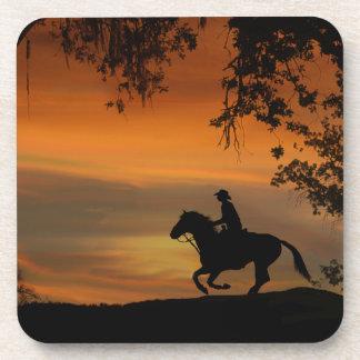 Montar a caballo del vaquero en los prácticos de posavasos