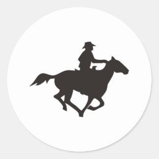 Montar a caballo del vaquero pegatina redonda