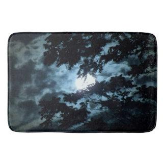 Moon Illuminates the Night behind Tree Branches Bath Mat