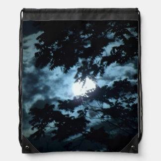 Moon Illuminates the Night behind Tree Branches Drawstring Bag