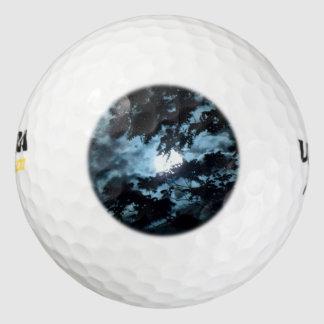Moon Illuminates the Night behind Tree Branches Golf Balls