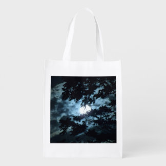 Moon Illuminates the Night behind Tree Branches Grocery Bag
