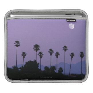 Moon over palm trees at dusk, Hollywood iPad Sleeves