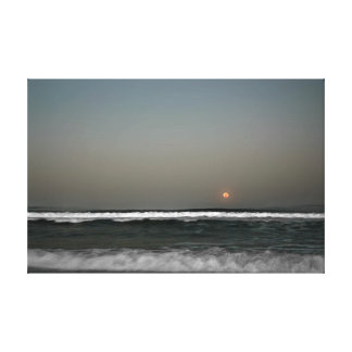 Moon Over Waves Canvas Print