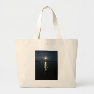 Moon reflection over water. bag
