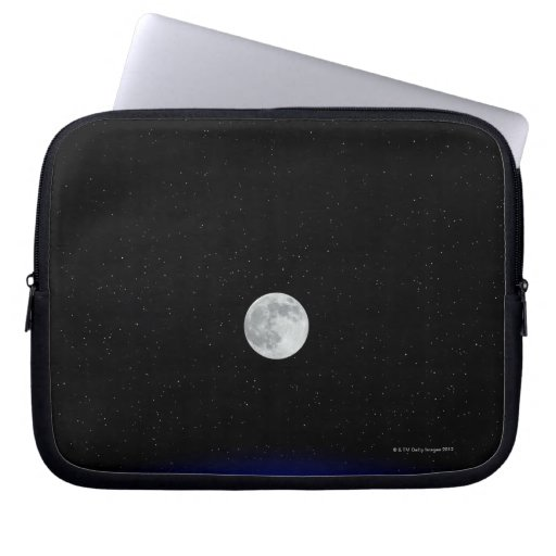 Moon rise over Earth Laptop Sleeves