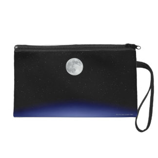 Moon rise over Earth Wristlet Purse