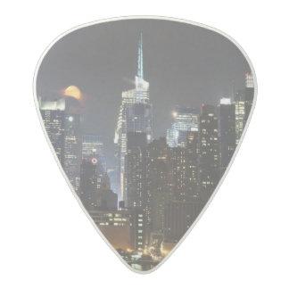 Moon rises over midtown New York. Acetal Guitar Pick