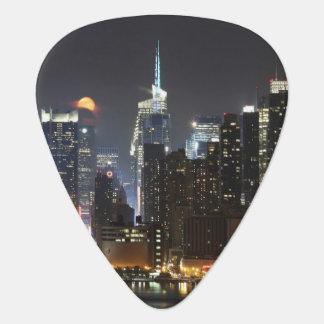 Moon rises over midtown New York. Guitar Pick