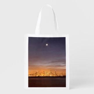 Moon setting over San Francisco on hazy December Reusable Grocery Bag