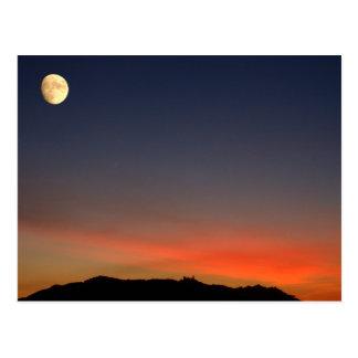 Moonrise over sunset postcard