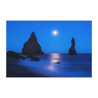Moonrise reflection on ocean and sea stacks canvas print