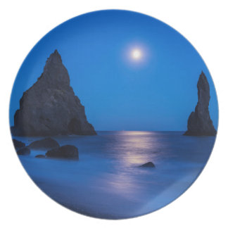 Moonrise reflection on ocean and sea stacks dinner plate