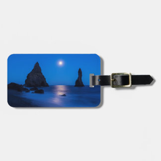 Moonrise reflection on ocean and sea stacks travel bag tags