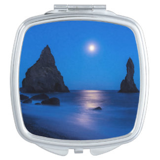 Moonrise reflection on ocean and sea stacks compact mirror