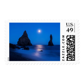 Moonrise reflection on ocean and sea stacks postage stamp