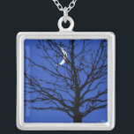 """Moonscape in Cobalt Blue and Black Silver Plated Necklace<br><div class=""""desc"""">&quot;Moon Shadows&quot; print - Digital art print of tree silhouette against a night sky with crescent moon. An interplay of light and shadow in deep blue,  black and white.</div>"""