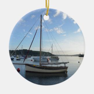 Moored sailing cutter at dawn. ceramic ornament