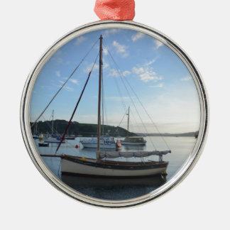 Moored sailing cutter at dawn. metal ornament