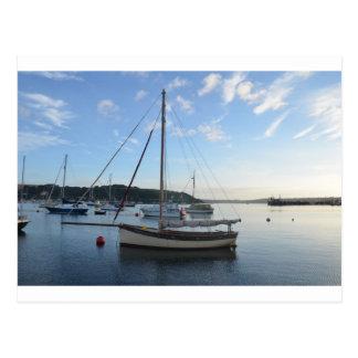 Moored sailing cutter at dawn. postcard
