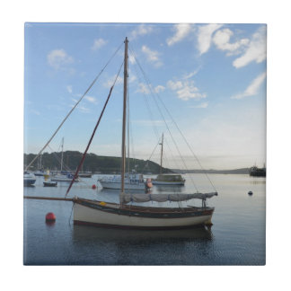 Moored sailing cutter at dawn. small square tile