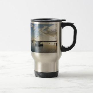 Moored yacht at dawn. travel mug