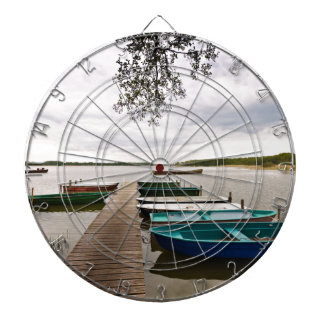 Moorings with boats on a lake dartboards